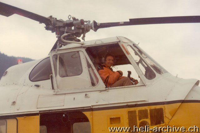 1975 - At the controls of the Sikorsky S-55T HB-XDS in service with Heliswiss