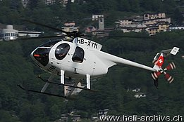 Lugano airport/TI, May 2009 - The MDD 369E HB-XYM in service with Border-X GmbH (www.airphototicino.com)