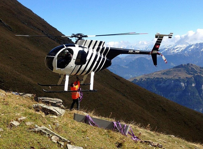 Swiss Alps - The Hughes 500D HB-ZRL in service with Heli-Tamina GmbH piloted by Remo Niederer