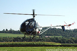 Belp/BE, September 2006 - The Schweizer 300C HB-ZHU in service with Heliswiss (K. Albisser)