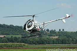 Belp/BE, August 2006 - The Schweizer 300C HB-XYL in service with Heliswiss (K. Albisser)