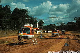 Suriname '70s - The Bell 206A/B Jet Ranger II HB-XCP together with the Agusta-Bell 204B HB-XCG both in service with Heliswiss (P. Aegerter)
