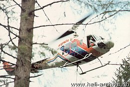 '90s - The Bell 214B-1 Big Lifter HB-XVZ in service with Air Grischa during a logging operation (HAB)