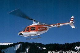 Swiss Alps, 1974 - The Bell 206A/B Jet Ranger II HB-XCT in service with Heliswiss (E. Devaud)