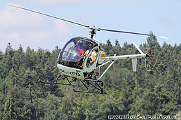 Epagny-Gruyères/FR, August 2013 - The Schweizer 300C HB-XFQ in service with Heliswiss (O. Colombi)