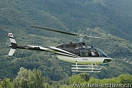 Locarno airport/TI, May 2014 - The Bell 206B Jet Ranger III HB-ZEB in service with Karen (M. Bazzani)