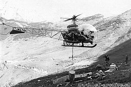 Swiss Alps, late 1960s - Transportation of gravel with the Agusta-Bell 47G3B-1 HB-XCI in service with Heliswiss (HAB)