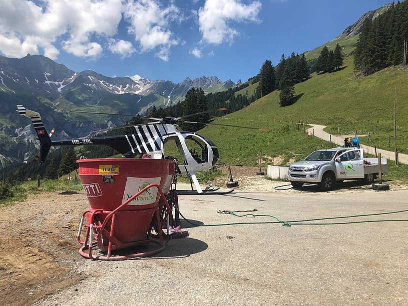 Swiss Alps - The Hughes 500D HB-ZRL in service with Heli-Tamina photographed during a short stop