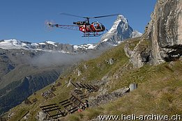 August 2010 - The SA 315B Lama HB-XSW of Air Zermatt photographed during the construction of an avalanche protection in Schweifinen/VS. In the backgroud the famous Matterhorn (H. Zurniwen)