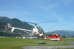 Locarno airport/TI, 20 September 2012 - David (Schweizer 300C HB-ZIF) and Goliath (Kamov KA-32A12 HB-XKE) - photo M. Bazzani