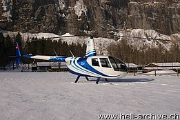 Lauterbrunnen/BE, December 2013 - The Robinson R-44 Raven II HB-ZFQ in service with Robin Air GmbH (B. Siegfried)