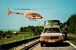Region of Berne, early '70s - The Agusta-Bell 206 HB-XCU in service with Heliswiss at work for the police department (HAB)