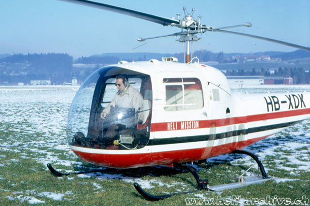 Berne/Belp airport, winter 1971 - The Swiss missionary Ernst Tanner at the controls of the Bell 47J Ranger HB-XDK (Helimission)