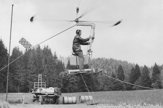 November 1957 - The Contraves helicopter prototype is tested in the countryland near Delémont. For security reasons the aircraft is restained with cables (Heli-Archiv Wernli)