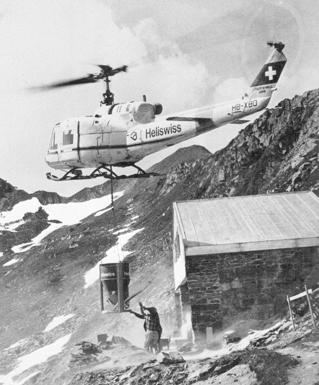 Image 7 - Swiss Alps, late 1960s - The Agusta-Bell 204B HB-XBO in service with Heliswiss tranports gravel for a mountain hut using a 800 litres aluminum bucket (HAB)