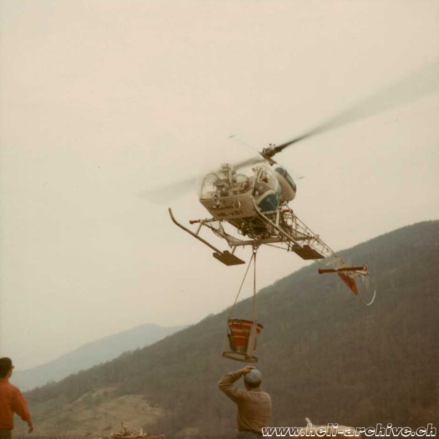 Image 5 - Late 1960s - The Bell 47G3B-1 HB-XBT in service with Heliswiss is used to tranport gravel with the new bucket (HAB)