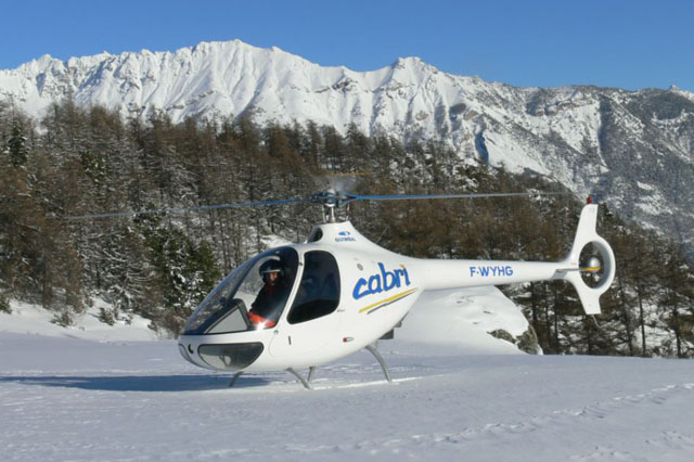 The Guimbal Cabri G2 F-WYHG photographed in a beautifull snowed alpine landscape (Hélicoptères Guimbal)