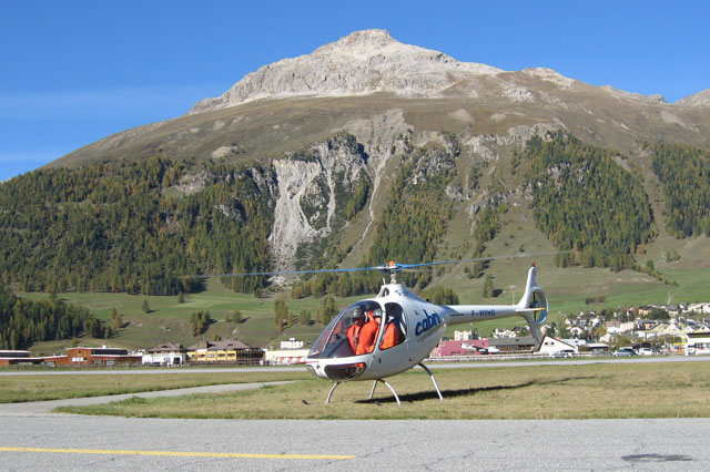 Samedan/GR, October 2006 - The Guimbal Cabri G2 F-WYHG in the beautiful scenario of the Swiss Alps. Built an elevation of 1,707 metres (5,600 ft), Samedan airport is the highest airliner airport in Europe (Hélicoptères Guimbal)