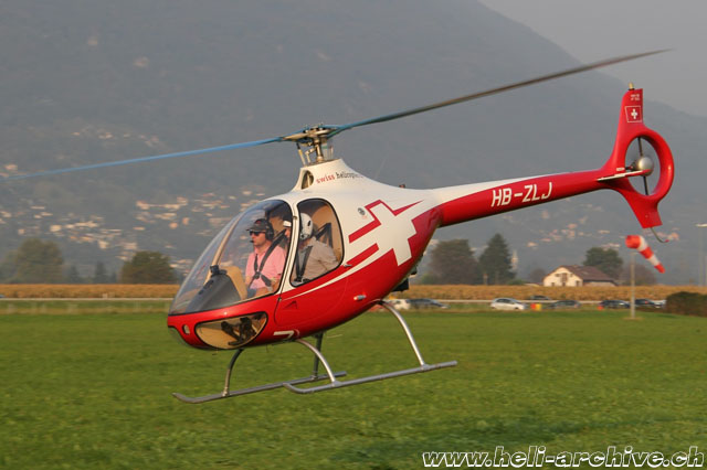 Locarno airport/TI, September 2014 - The Guimbal Cabri G2 HB-ZLS in service with Swiss Helicopter with a new paint scheme (M. Ceresa)