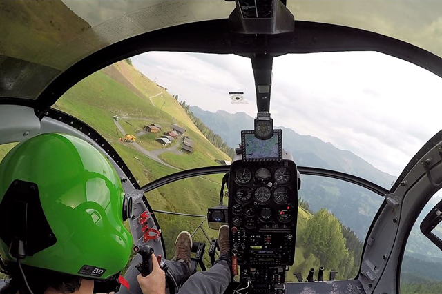 Swiss Alps - In flight with the Hughes 500D HB-ZRL in service with Heli-Tamina