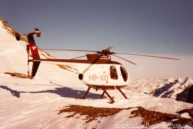 Swiss Alps, early 1980s - The Hughes 500D HB-XIO of the Swiss operator Robert Fuchs (HAB)