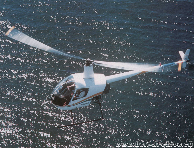 The Robinson 22 N32AD in flight over the Pacific ocean (HAB)