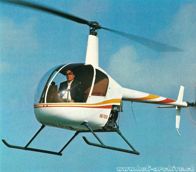 1976 - Frank Robinson at the controls of the R22 N67010 (HAB)