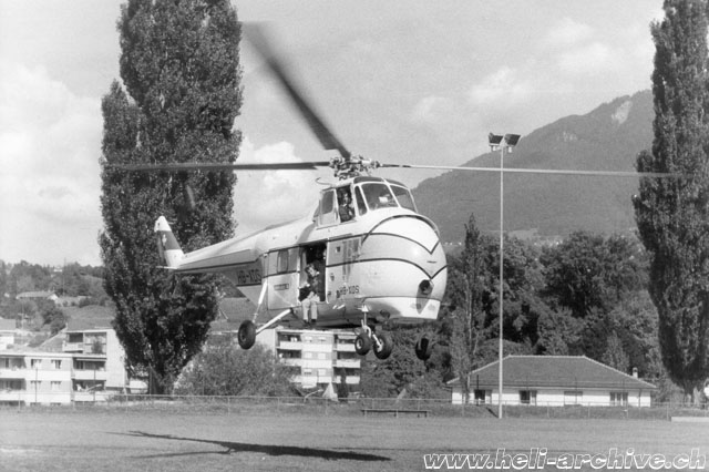 Summer 1975 - The Helitech-Sikorsky S-55T HB-XDS photographed while it hovers over a soccer field. The pilot is Ernest Devaud (E. Devaud)