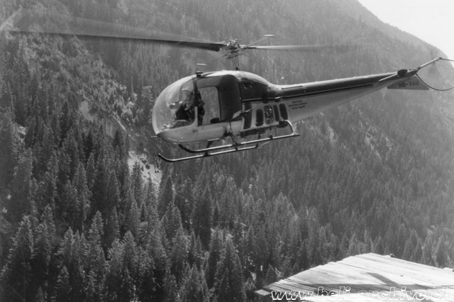 The Bell 47J Ranger HB-XAU engaged in the transportation of building material in the almost inaccessible valley of Massa (HAB)