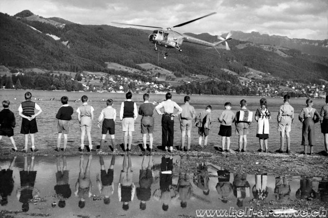 Lake of Thun/BE, September 1953 - A crowd of astonished young spectators observe the Bristol 171 Mk. 4 G-AMWI in action (archive M. Mau)