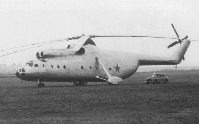 1957 - The prototype of the Mil Mi-6 photographed at Zakharkovo airfield. Compare the size of the helicopter with those of the car (archive Mil)