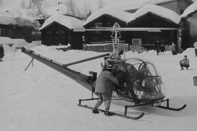 March 1955 - The Hiller UH-12B HB-XAH piloted by Sepp Bauer is employed to transport supplies to the mountain village of Zermatt isolated by heavy snow fall (HAB)