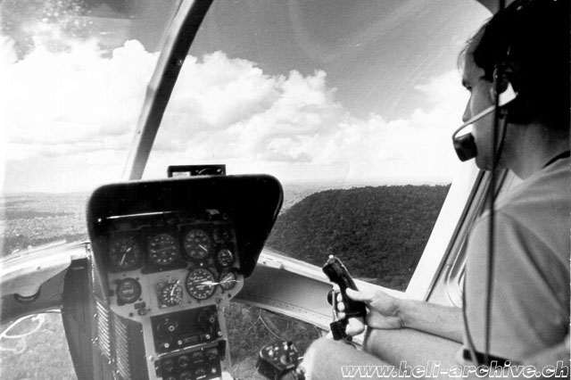 Suriname 1971 - Fernand Cardinaux at the controls of the Bell 206A Jet Ranger HB-XDD (family Cardinaux)