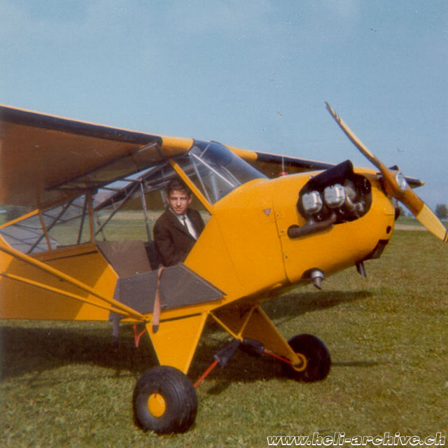 Ernest Devaud at the controls of a Piper PA-18 Cub