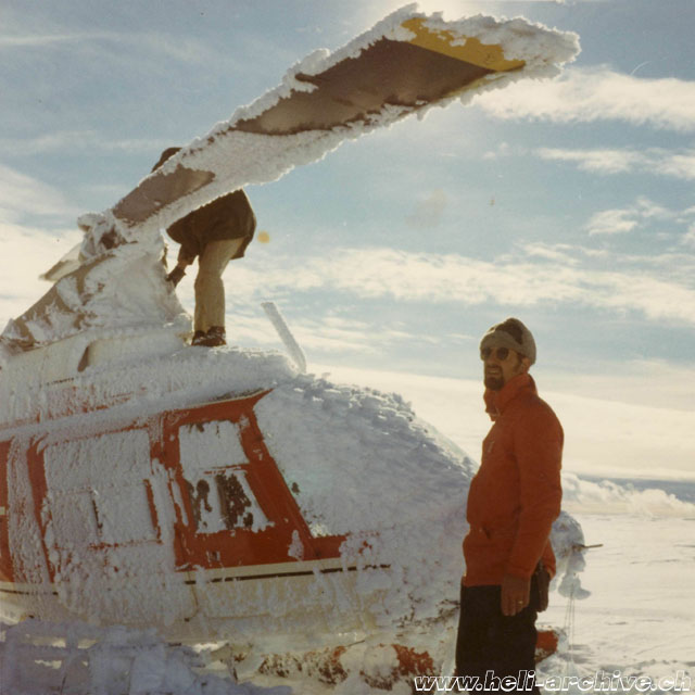 Greenland, August 1971 - Silvio Refondini observes the effects of a blizzard which invested the Bell 206A Jet Ranger HB-XCT in service with Heliswiss (S. Refondini)