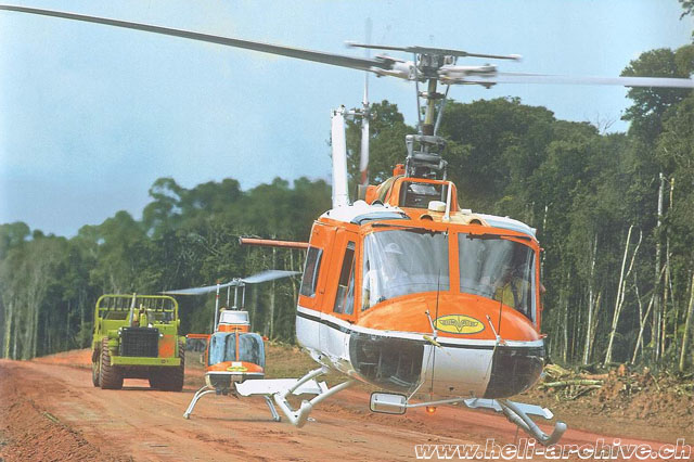 Suriname - JB Schmid at the controls of the Agusta-Bell 204B in service with Heliswiss (P. Aegerter)