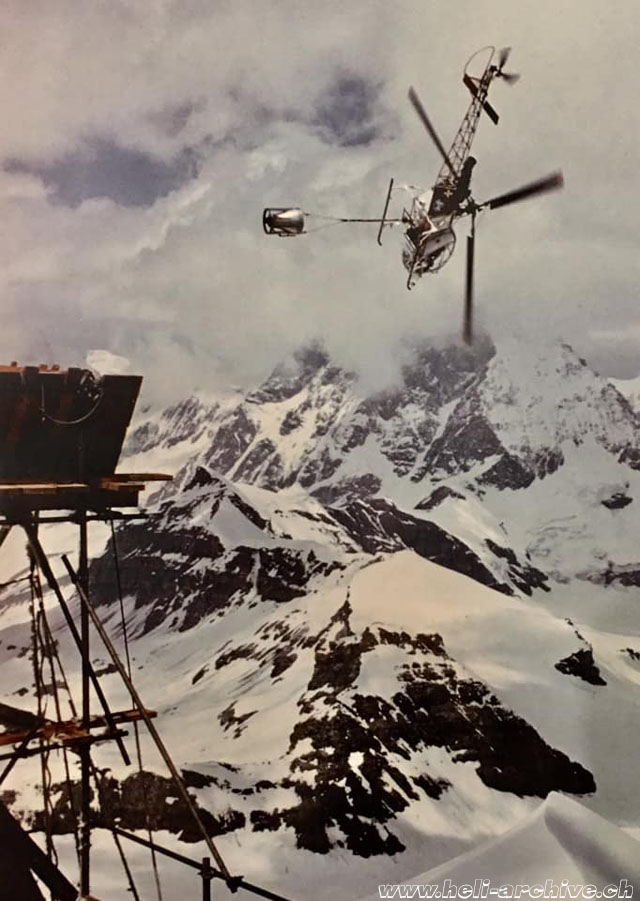 1976-1979 - Bernd Van Doornick in action with the SA 315B Lama HB-XEV during the construction of the cable-car end station on the Klein Matterhorn, at that time the highest construction site in Europe at an altitude of 12,500 ft/3'820 m/asl (archive BVD)