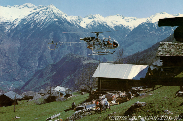 Transportation of building material in Valle Calanca with the SA 315B Lama HB-XMC of Air Grischa (family von Wyl)